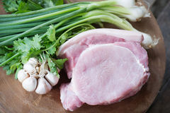 Raw pork meat. With vegetables Stock Photo