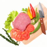 Raw pork meat with vegetables and herbs. Raw pork meat isolated with vegetables and herbs Stock Photo