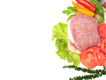 Raw pork meat with vegetables and herbs. Raw pork meat isolated with vegetables and herbs Royalty Free Stock Photo