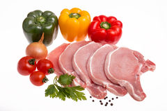 Raw pork meat, vegetables and spices, arranged on kitchen board Royalty Free Stock Image