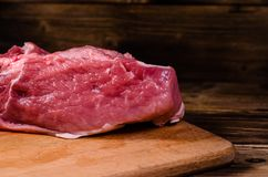Raw pork meat on cutting board. Raw pork meat on wooden cutting board Royalty Free Stock Images