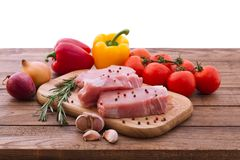 Raw pork meat on wooden desk Stock Images