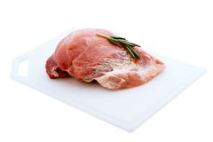 Raw pork meat on wooden desk. Raw pork meat with spices and vegetables isolated Stock Photo