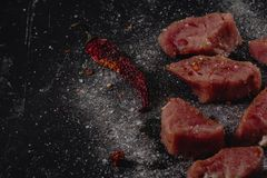 Raw pork medalions meat. Fresh steaks on black background. 45 degree stock image