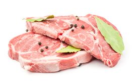 Raw pork neck cut isolated on white. Raw pork neck meat cuts with black pepper and bay leaves isolated on white background fresh two slices without bone Stock Image