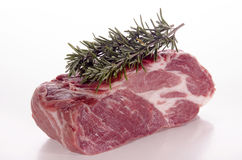Raw pork neck with rosemary Stock Photos