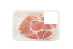 Raw pork  in packaging tray with price tag Stock Image