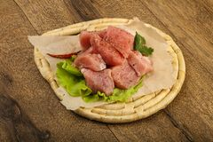 Raw pork pieces. With pepper and salt - ready for cooking Royalty Free Stock Image