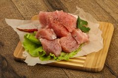 Raw pork pieces. With pepper and salt - ready for cooking Stock Photos
