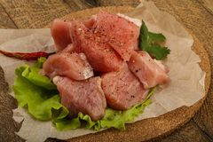 Raw pork pieces. With pepper and salt - ready for cooking Stock Photo