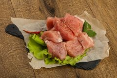 Raw pork pieces. With pepper and salt - ready for cooking Stock Images