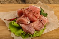 Raw pork pieces. With pepper and salt - ready for cooking Stock Image
