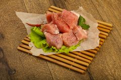 Raw pork pieces. With pepper and salt - ready for cooking Royalty Free Stock Photos