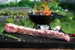 Raw pork rib on the black cutting board royalty free stock image
