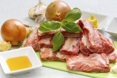 Raw pork ribs on a cutting board Stock Image
