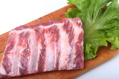 Raw pork ribs with herbs and spices on wooden board. Ready for cooking. Raw pork ribs with herbs and spices on wooden board. Ready for cooking Stock Images