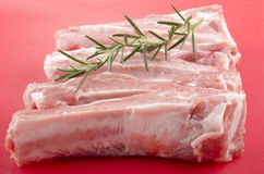 Raw pork ribs and rosemary Royalty Free Stock Images