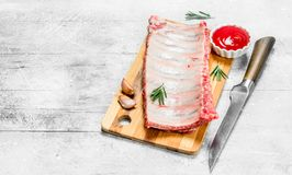 Raw pork ribs with spices and sauce stock photography