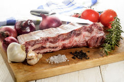 Raw pork ribs on a wooden board Stock Photo