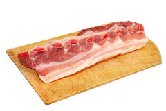 Raw pork ribs on wooden cutting board.Isolated. Raw pork ribs on wooden cutting board isolated on white background Stock Photography