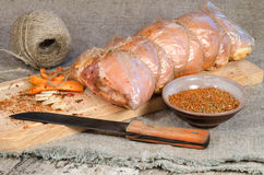 Raw pork roll package for roasting on wooden cutting board Royalty Free Stock Photos
