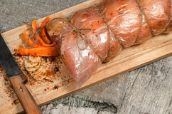 Raw pork roll package for roasting on wooden cutting board Royalty Free Stock Images