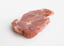 Raw pork scotch fillet steak. On white Royalty Free Stock Photo