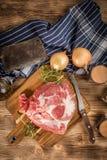 Raw pork shoulder. Raw pork shoulder on cutting board with knife Stock Image