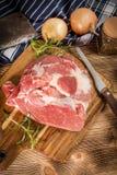 Raw pork shoulder. Raw pork shoulder on cutting board with knife Stock Photo