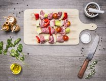 Raw pork on  skewer  bell peppers, onions,  tomatoes and spices, with  garlic sauce, tomato paste and dill seasoning, oil and bla. Raw pork on a skewer  bell Stock Images