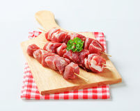 Raw pork skewers Stock Photos