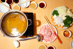 Raw Pork Slice ,Freshness Vegetable on Wooden Table and Soup Hot. Pot. Shabu Japanese Food. Top View Stock Images