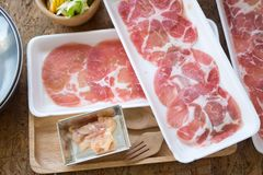 Raw pork slice on plate for hot pot. In food set Stock Photography