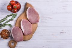 Raw pork slice. With spice and herbs on white background Stock Photo