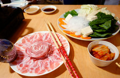 Raw Pork Slice in White Round Plate and Freshness Vegetable. On Wooden Table. Shabu Japanese Food Stock Photography