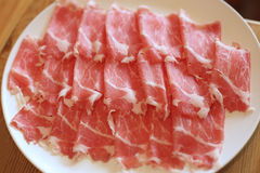 Raw pork sliced in white dish for shabushabu, Japanese recipe.  Royalty Free Stock Photography