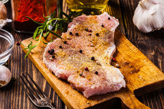 Raw pork slices prepared for roast with spices Royalty Free Stock Images
