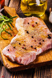 Raw pork slices prepared for roast with spices Stock Photography