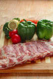 Raw pork spareribs and vegetables Stock Photos