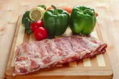 Raw pork spareribs and vegetables Royalty Free Stock Photos