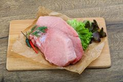 Raw pork steak. With dill and pepper ready for cooking royalty free stock images