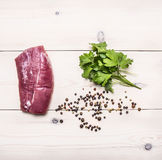 Raw pork steak with pepper and fresh parsley wooden rustic background top view close up stock photos