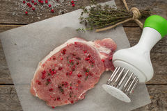 Raw pork steak with pink pepper and sea salt Stock Photo