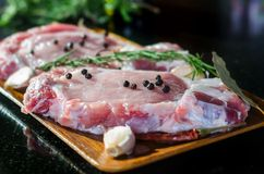 Raw pork steak ready for cooking with chili and rosemary Royalty Free Stock Photography