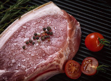 Raw pork steak on ribs.  the grill pan. Royalty Free Stock Image