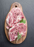 Raw pork steak with spices. Royalty Free Stock Photography