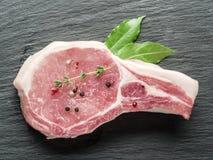 Raw pork steak with spices. Royalty Free Stock Photos