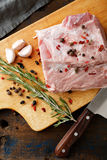 Raw Pork steak with spices and herbs on wooden cutting board Royalty Free Stock Photography