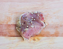 Raw pork  steak with spices Stock Photos