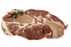 Raw pork steak on white background close-up. With a sprig of dill on top. Isolated Royalty Free Stock Images